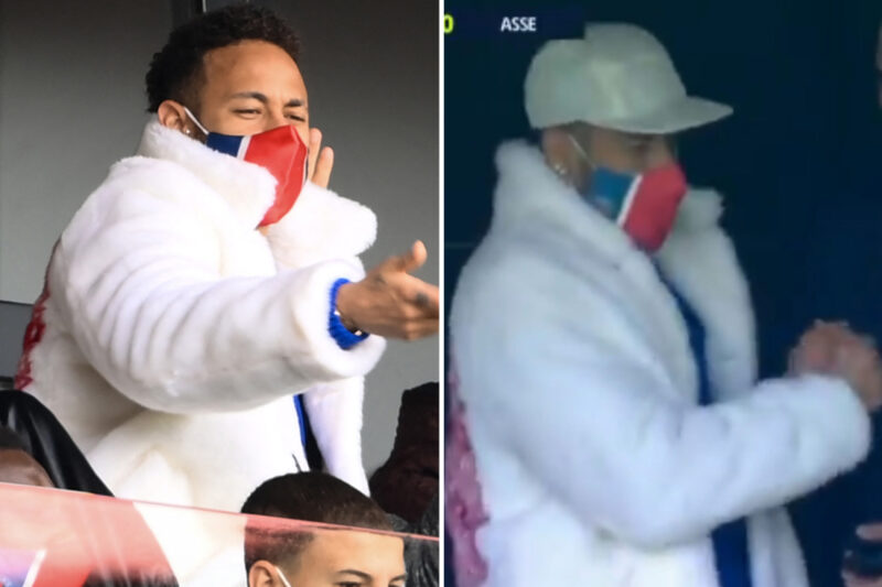 Suspended PSG star Neymar wears huge furry white coat as he cheers on team-mates against St Etienne from the stands