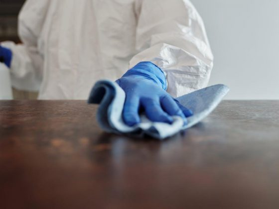Close-Up Photo Of Person Cleaning The Table