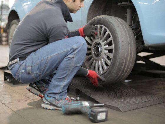 man changing a car tire