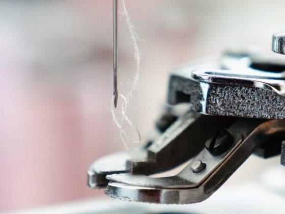 silver sewing machine in tilt shift lens