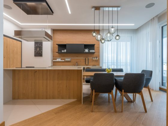 modern wooden furniture and appliances in spacious kitchen